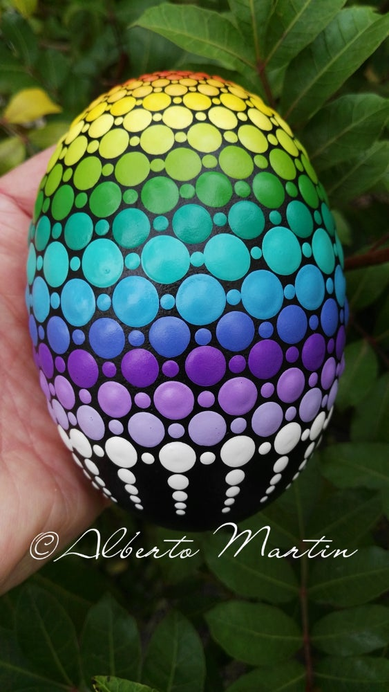 Image of Magical Rainbow dot art Painted egg-shaped stone by Alberto Martin