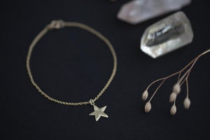 Image of 9ct gold star bracelet