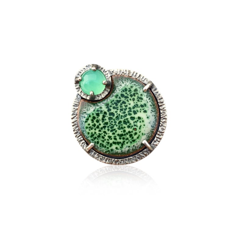 Image of eclipse ring in chrysoprase and mossy green enamel