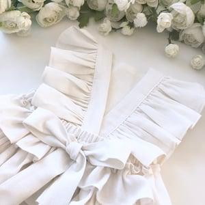 Image of White linen ruffle romper