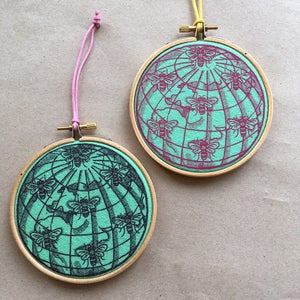 Image of Manchester worker bee globe printed wall hanging ornament