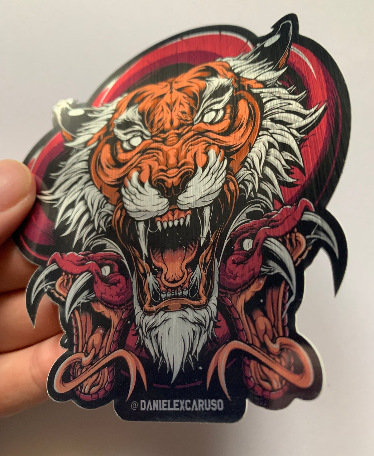 Image of Tiger and Snakes Brushed Aluminium Sticker 9.5 x 10.4 cm