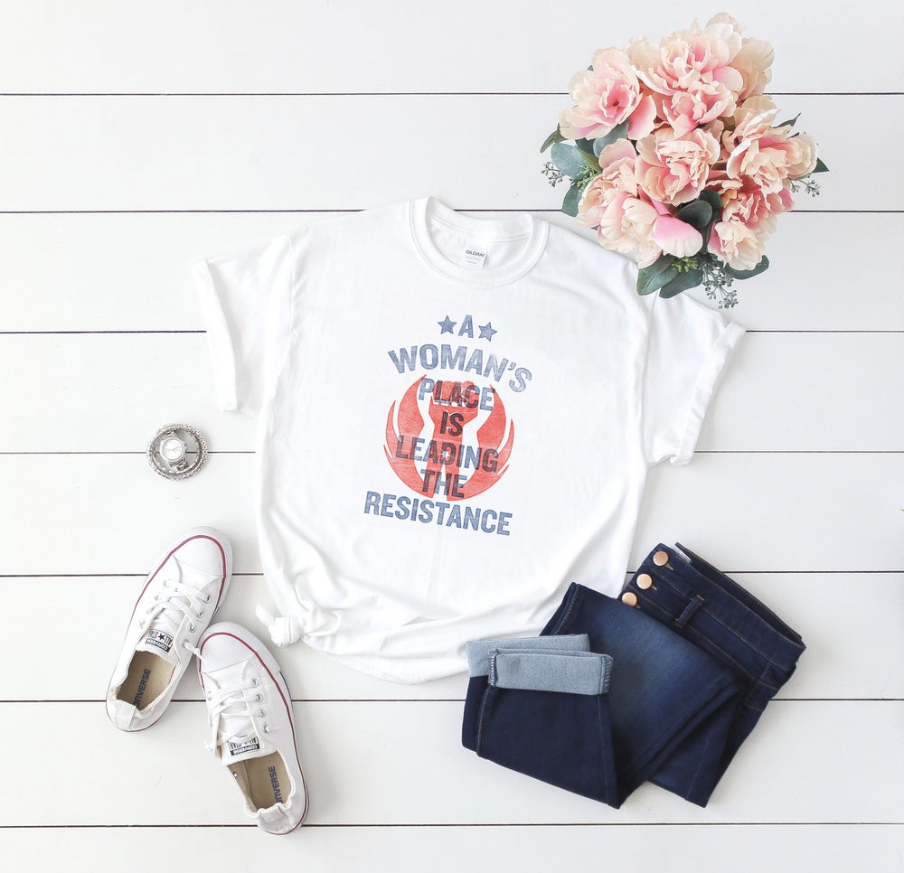 Image of WHITE: A Woman's Place Is Leading The Resistance Shirt