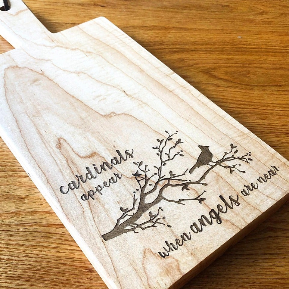 "Image of ""Cardinals appear..."" engraved maple board"
