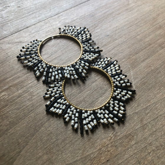 Image of Matte black & bone feather sunburst earrings