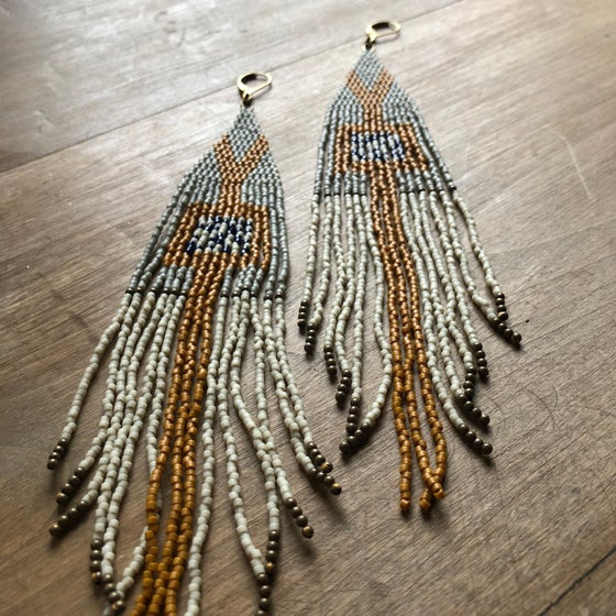 Image of Mustard, warm grey, bone, and deepest navy fringe earrings