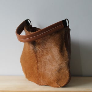 Image of Frankie in Caramel Cow Hide