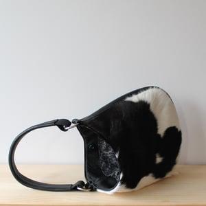 Image of Frankie in Black Cow Hide
