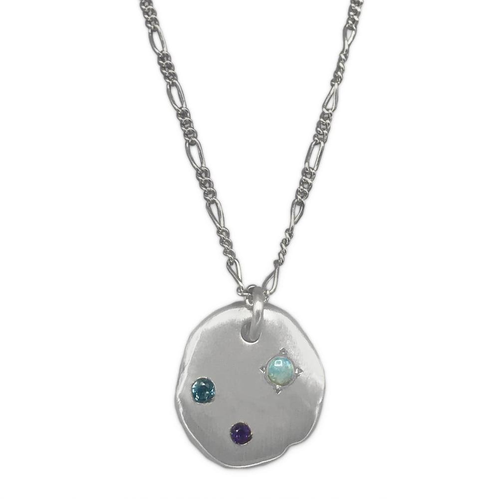 Image of rock pendant w/ blue topaz, amethyst & opal (P1811620)