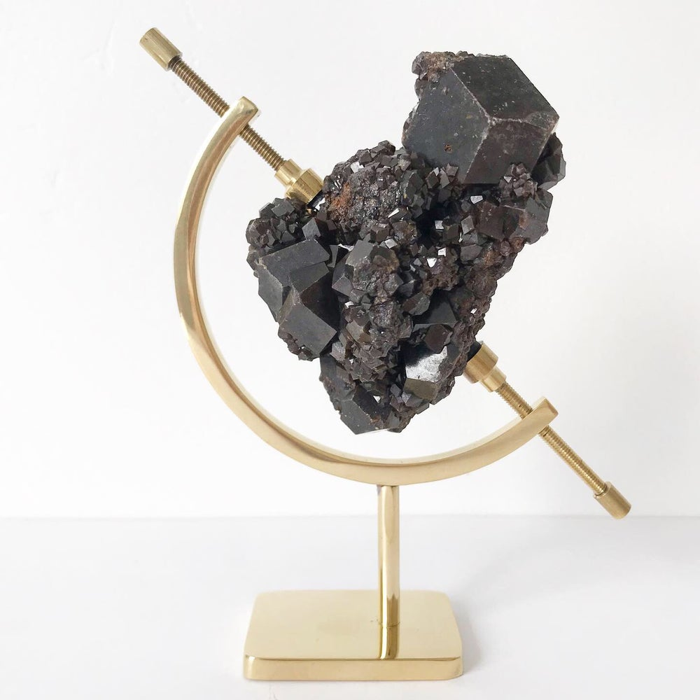 Image of Garnet no.24 + Brass Arc Stand