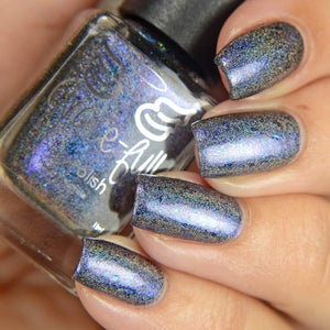 Image of Helms Deep Fortress – a black based linear holo with blue-purple aurora shimmer & chrome flakies