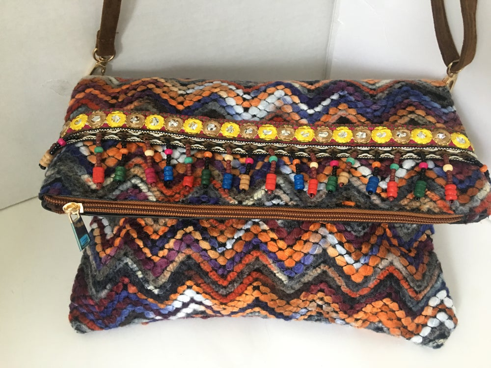 Image of embroidered clutch