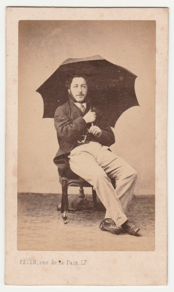 Image of Feyen: man posing with umbrella, Paris ca. 1860
