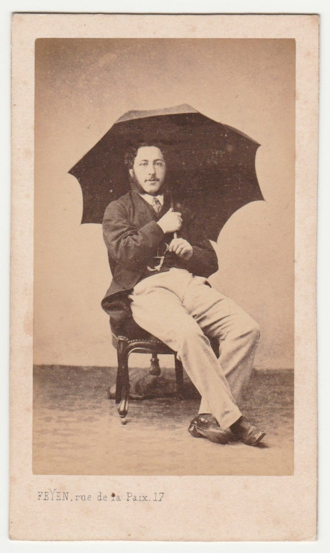 Image of Feyen: man posing with umbrella, Paris ca. 1860