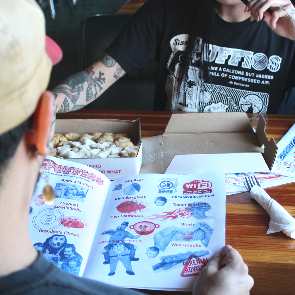 "Image of ""Int'l Puffio Day"" - White on Black Unisex Tee *Riso Zine and Pizza box included"