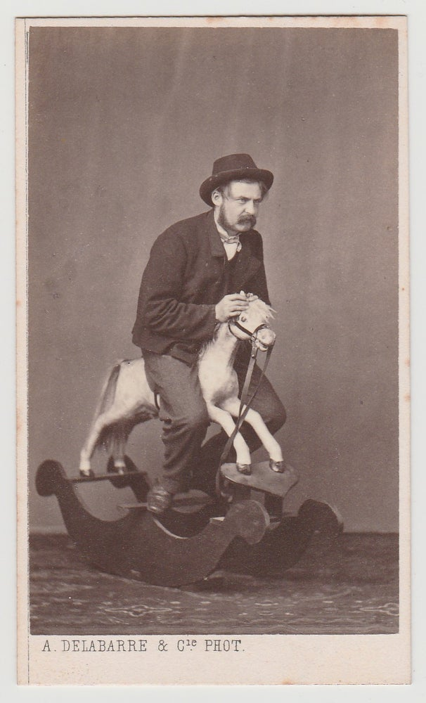 Image of Albert Delabarre: adult man on a rocking horse, Brussels ca. 1870