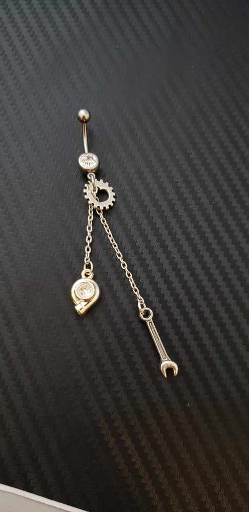 Image of Layered Car Part Belly Rings