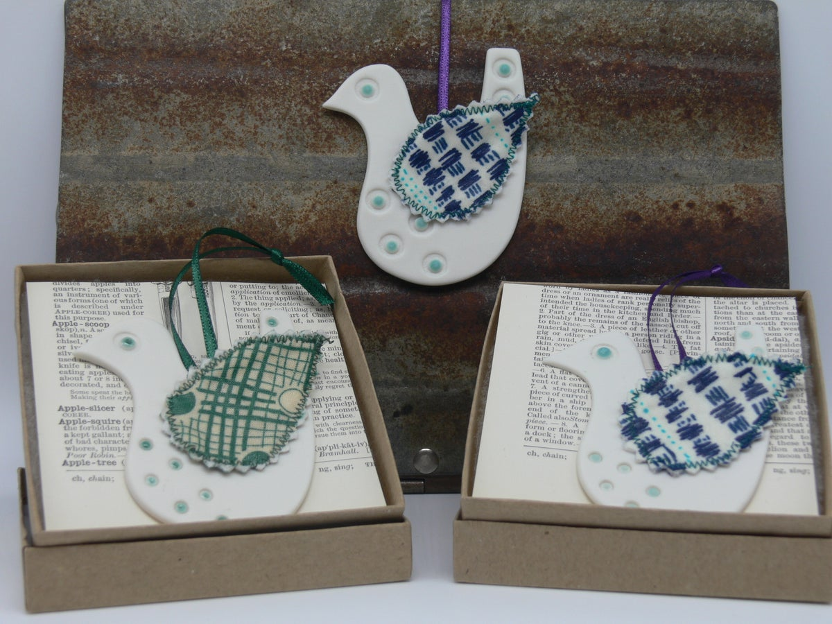 Image of Porcelain Bird with Fabric Wing