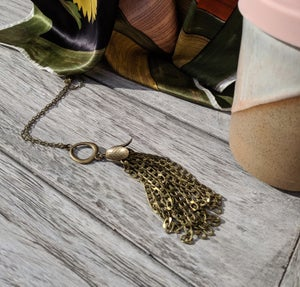 Image of chunky brass tassel necklace