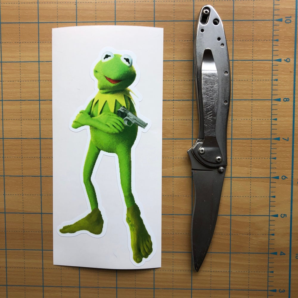 Image of Kermit with sexy green feet and a gun Vinyl Sticker