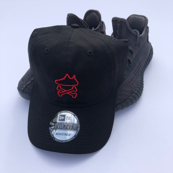 "Image of YEEZY CROSSBONES EMBROIDERY ""BLACK/RED"" DAD HAT"