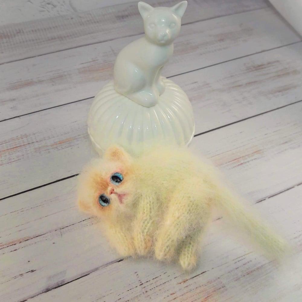Image of Portrait sleepy toy cat, pocket size
