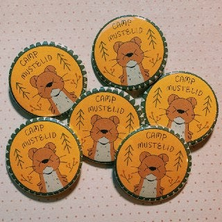 Image of camp mustelid button