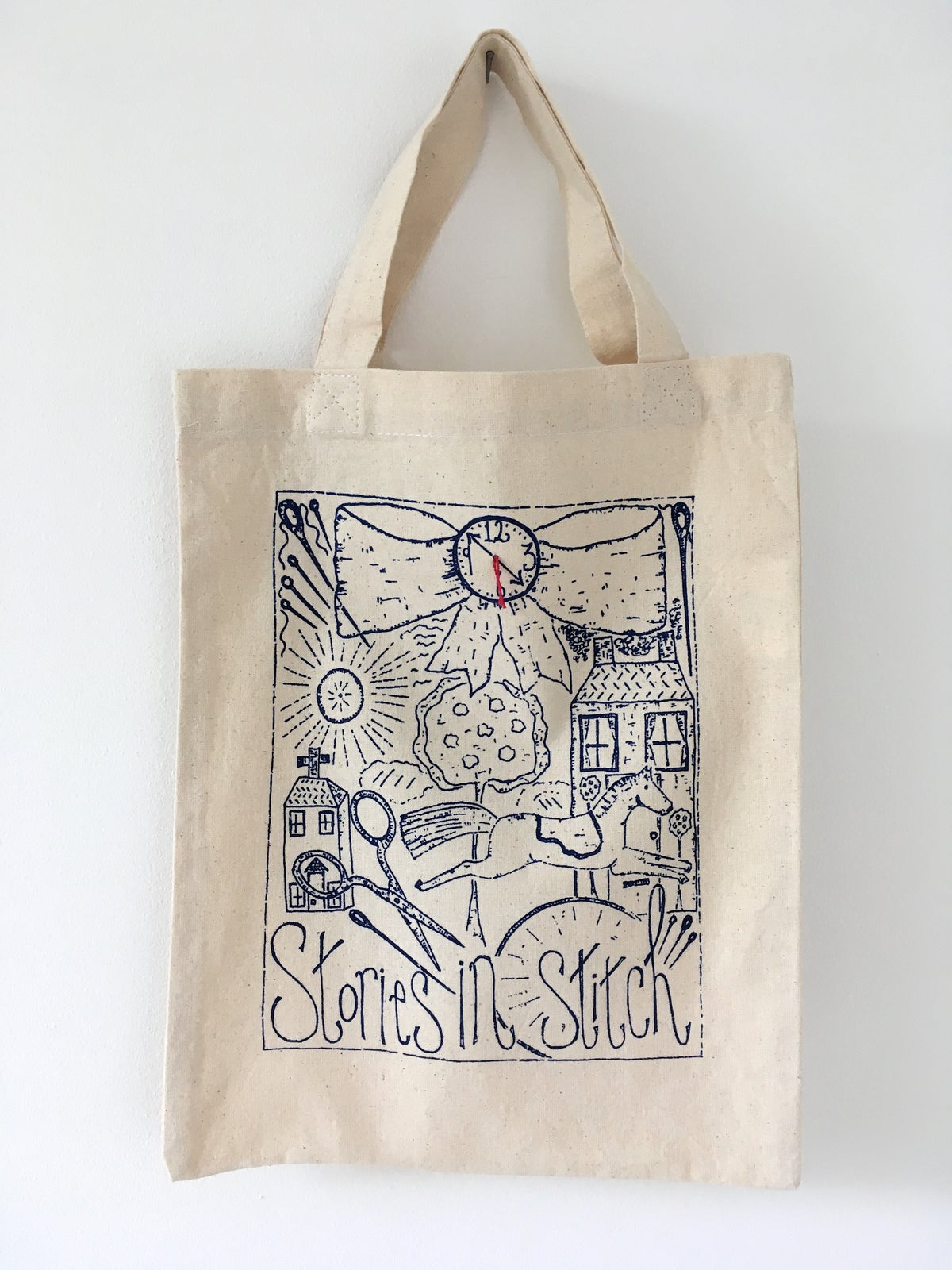 Image of Stories in stitch small cotton tote bag