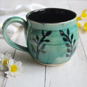 Image of Gorgeous Crackled Turquoise Pottery Mug with Hand Painted Floral Design, Made in USA