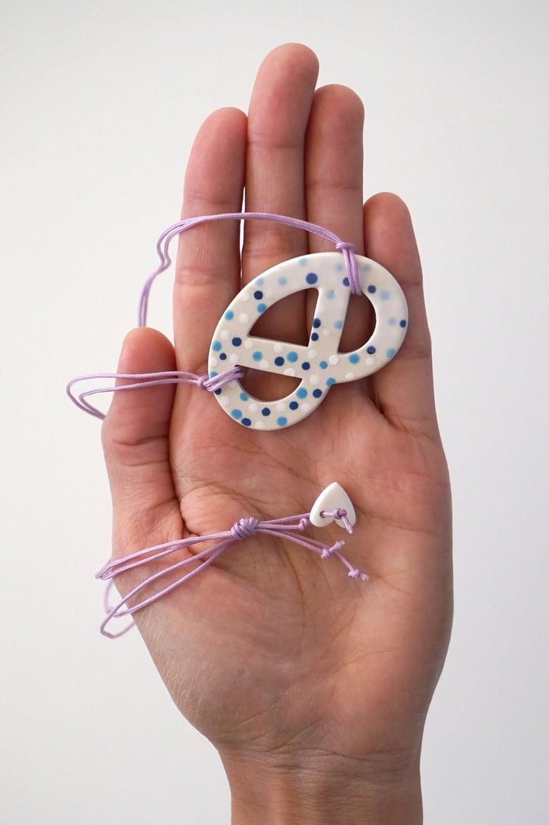 Image of Lilac Fizz – Ceramic Pretzel Pendant