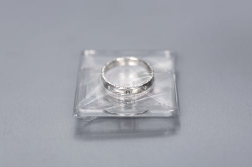 Image of silver ring for children with inscription in Latin