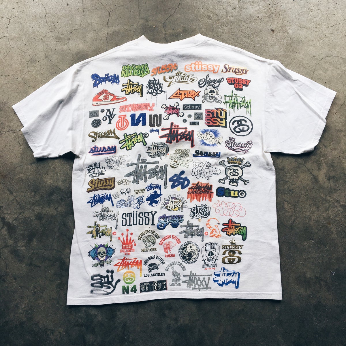 Image of Original Early 2000's Stussy Full Print Logo Tee.