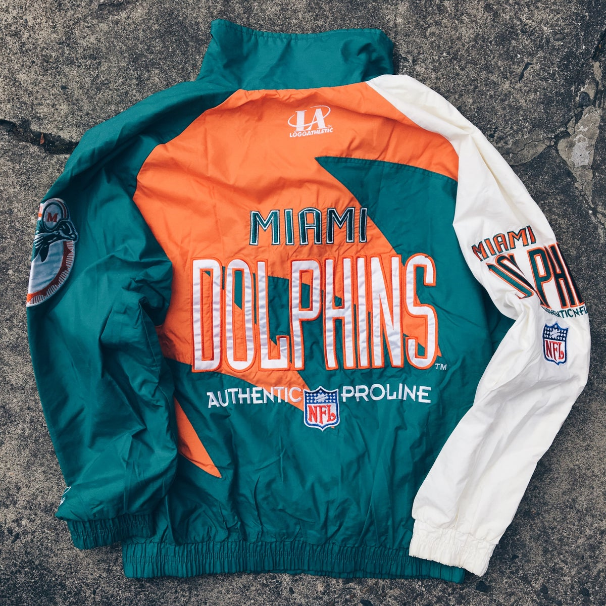 "Image of Original 90's Logo Athletics ""Sharktooth"" Miami Dolphins Jacket."