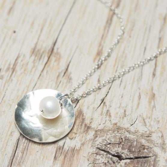 Image of pearl in shell necklace