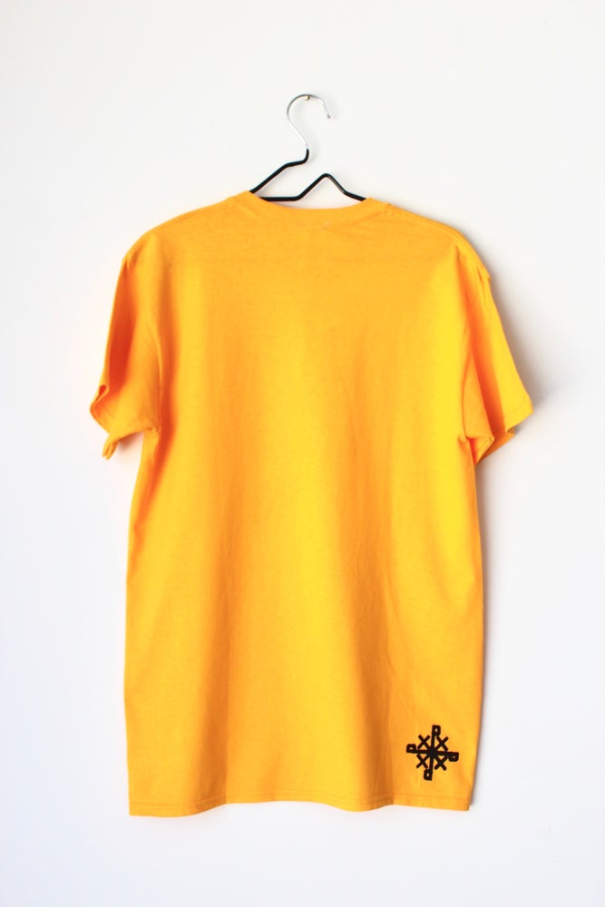 Image of blame the system not the victim tee in yellow