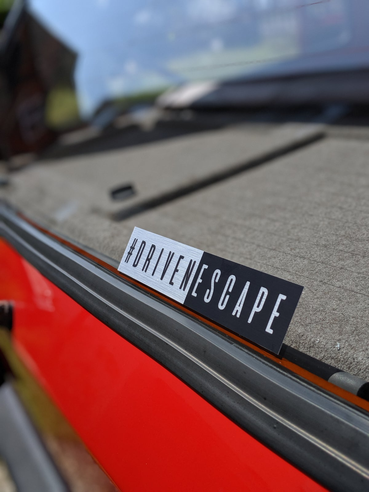 Image of Brushed Aluminium #DrivenEscape Slap Sticker