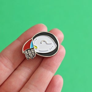 Image of Puffin eating fish enamel pin - silver plating - bird pin - sea bird - nature pin - lapel pin badge