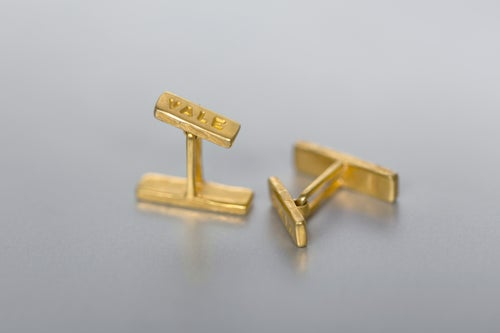 Image of silver cufflinks with gilding and inscription in Latin