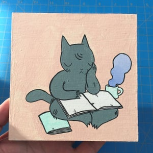 Image of Cat Dozing off while Reading Painting