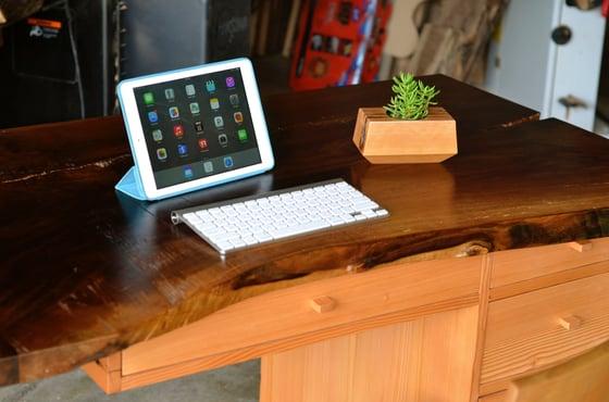 Image of walnut waterfall desk