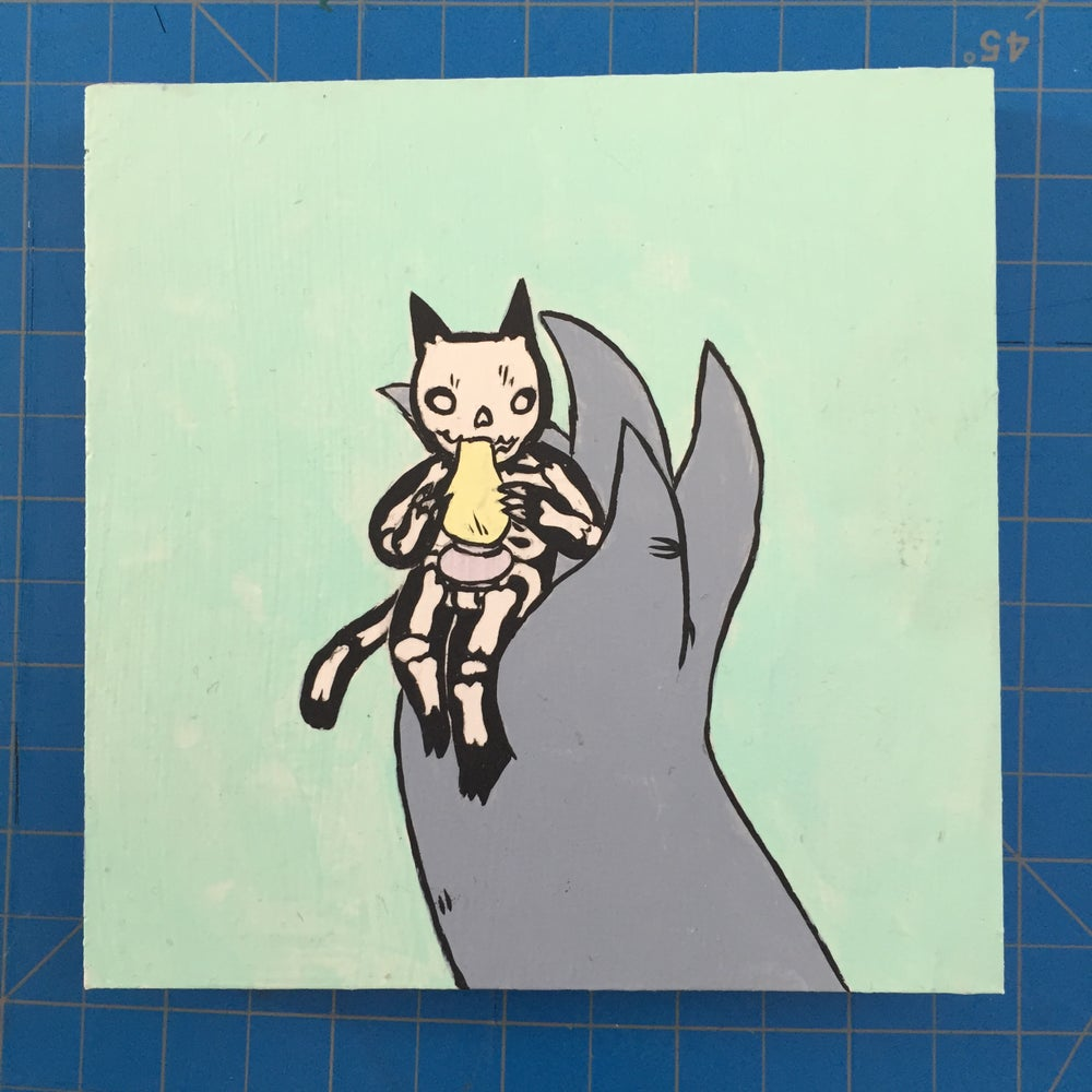 Image of Giant holding Skeleton Cat Painting