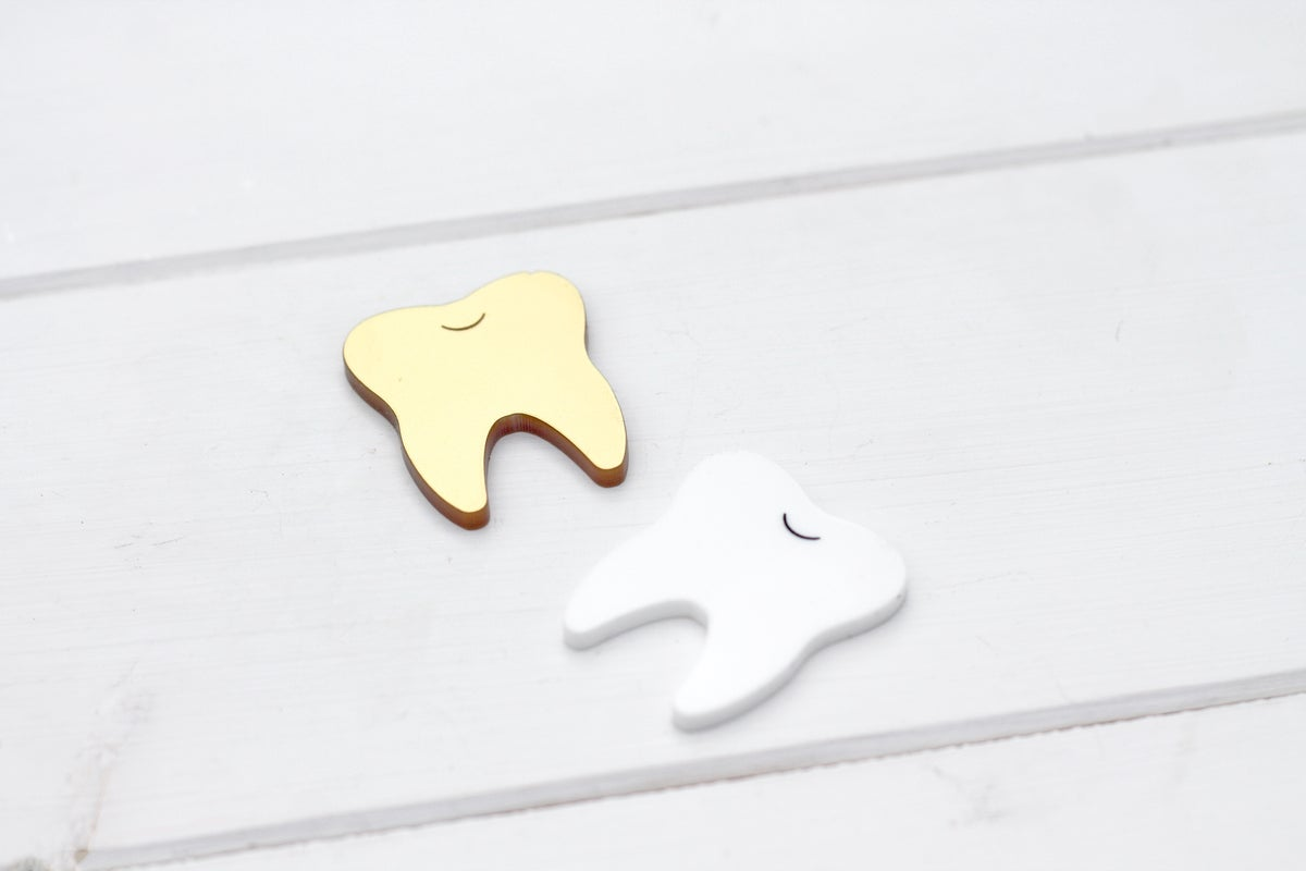 Image of Gold Tooth Pin Brooch