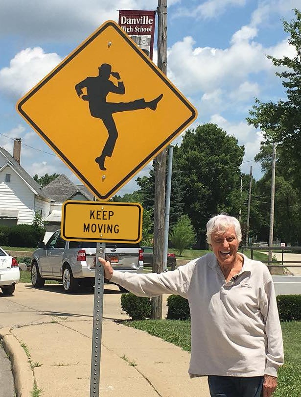 "Image of Dick Van Dyke ""Keep Moving"" Sign"