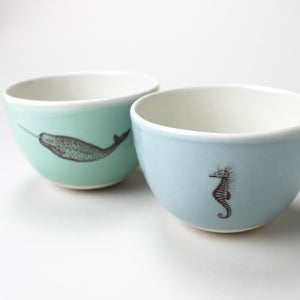 Image of roly soup/cereal/yogurt bowls, set of two, with narwhal and seahorse