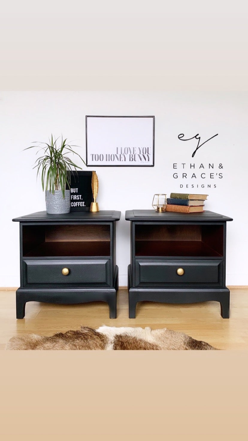 Image of A pair of black stag mahogany bedside tables.