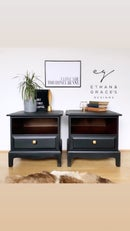 Image 1 of A pair of black stag mahogany bedside tables.