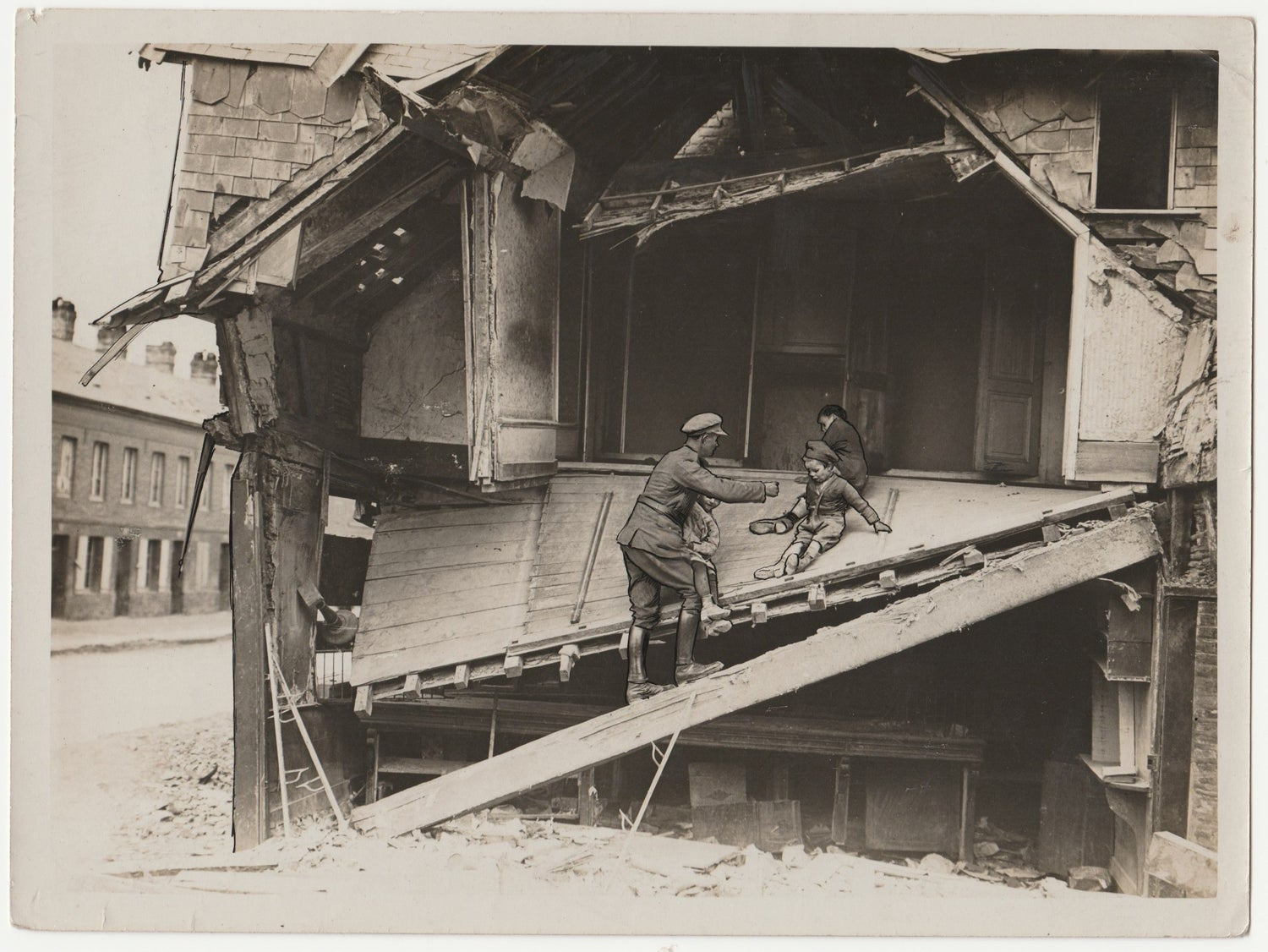 Image of Associated Illustration Agencies: A Tommy helping children from a ruined house, ca. 1916