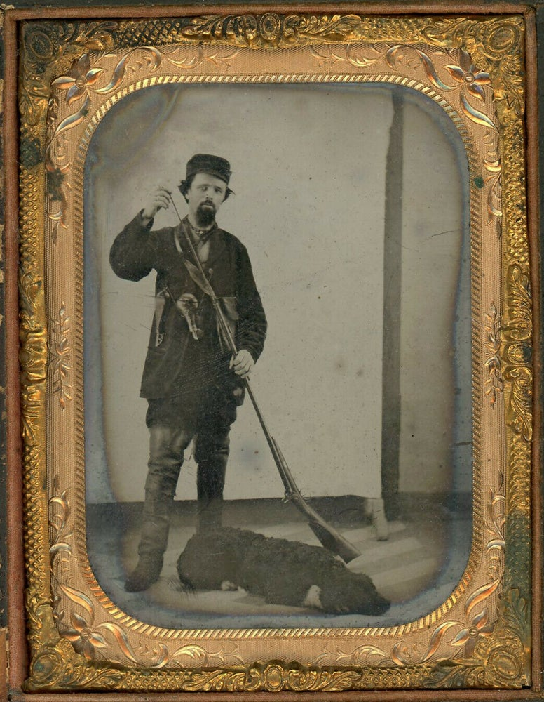 Image of Anonymous: hunter with his dog loading rifle, ca. 1860