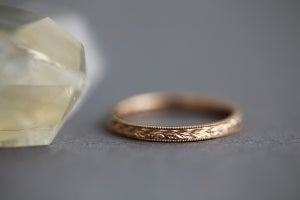 Image of 18ct Rose gold 2mm flat court laurel leaf and milled edged engraved