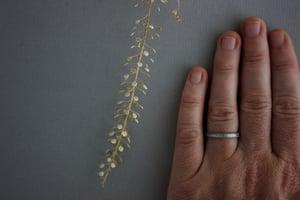 Image of Platinum 2mm flat court laurel leaf and milled edge engraved